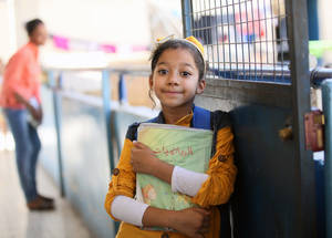"Aya is an inspiring example of bravery and resilience. With her prosthetic limb, she feels like herself again and dreams of becoming a dentist in the future. She believes that she and her friends must study hard so they can give back to their community. ""I love going to school!"" she says. Jaramana camp, Damascus. © 2015 UNRWA Photo by Taghrid Mohammad"