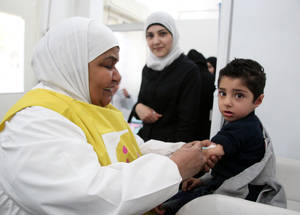 """I came here for the vaccinations and the support,"" says one mother. ""Here they weigh my baby, they take the height, everything is so good."" Five UNRWA health points offer vaccination services, and approximately 9,000 Palestine refugee children are immunized each year. Qabr Essit, Damascus. ©2015 UNRWA Photo by Taghrid Mohammad"
