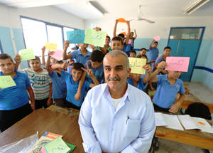 Yousif has been teaching at Dheisheh Basic Boys' School for 30 years. He himself was a student at the school, and his four children also studied at UNRWA schools. UNRWA-provided education has given the whole family a solid start on their paths to success: Yousif's youngest son is now studying business at university; one daughter is a lawyer; the other a teacher; and his other son is an engineer. © 2015 UNRWA Photo by Isabel de la Cruz