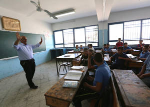 Yousif's initiatives also include linking students with local community organizations, for example those that promote art, creativity and sport, to help them further develop their talents. Similarly, he arranges visits to institutions such as courts, to educate students about the wider community, and universities, so they can explore their options for the future. © 2015 UNRWA Photo by Isabel de la Cruz