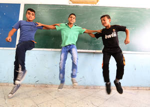 "Within the classroom, Yousif uses drama, comedy, games and other interactive methods to energize students and promote learning. ""This is part of an integrated learning approach. When students seem sad or bored, I change the style,"" he explains. Methods like those taught by Yousif were cited in a 2014 World Bank study as one of the reasons UNRWA students excel in their education, outperforming peers by an average of a year of schooling.  © 2015 UNRWA Photo by Isabel de la Cruz"