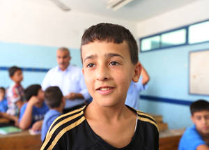 """Teacher Yousif doesn't only teach us from books, but also through other activities, and through comedy and drama. He also teaches us about ourselves and our communities,"" says student Adam, 13. Thanks to the generosity of those willing to support the UNRWA education programme, notably the United States, students like Adam and the other 500,000 kids in UNRWA schools can see a bright future ahead. © 2015 UNRWA Photo by Isabel de la Cruz"