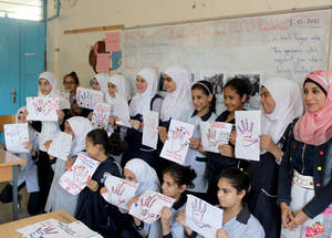 Iman's initiative helped improve communication between students in the classroom. It also helped her pupils understand and relate to one another, thus decreasing incidents of bullying among students. © 2015 UNRWA Photo by Abdul Nasser Al-Saadi