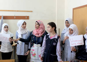 "On 'No Bullying Day', parents and education staff were invited to listen to the kids share their heartwarming testimonies,"" says Iman. ""The students sang and delivered speeches that emphasized the importance of tolerance and accepting others, and the need to stand up against bullying. © 2015 UNRWA Photo by Abdul Nasser Al-Saadi"