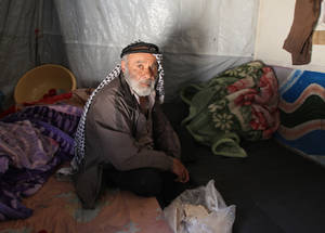 More than 12,000 of the most vulnerable Palestine refugees are living in temporary collective shelters established by UNRWA in former schools. Each classroom houses up to three families, with others living in tents pitched in the school yard. Neither option provides sufficient protection from the extremes of the Syrian climate, which can be blisteringly hot in the summer and freezing cold in the winter. In the photo, a man finds shelter in a school in Dummar, Damascus. © 2015 UNRWA Photo by Taghrid Mohammad