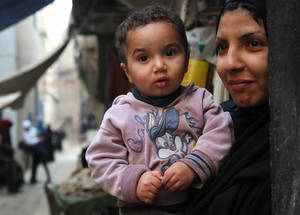 "Female-headed households and those who are renting housing are significantly more food insecure and more likely to have children who skip two or more meals per week despite the cash assistance. One mother in Damascus is faced with paying an annual rental of SYP 105,000 (EUR 423) to house her four children. ""I face enormous hardship, and I struggle to put food on my table and buy milk for my children,"" she said. © 2014 UNRWA Photo by Taghrid Mohammad"