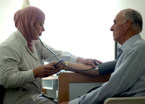 Many elderly beneficiaries of cash assistance spend the money they receive on health-related costs, including medicine for sick family members. The cost of medical care (including pharmaceuticals, hospitalizations and private care) has risen by 60 per cent since the start of the Syrian conflict. © 2015 UNRWA Photo by Taghrid Mohammad