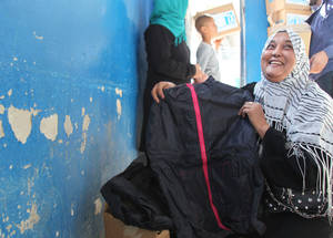 To help families cope with the cold at the onset of winter, UNRWA distributed blankets and mattresses to Palestine refugees in Khan Dunoun. The Agency also launched its #shareyourwarmth fundraising campaign to encourage people around the world to lend support to Palestine refugees this winter. Khan Dunoun © 2015 UNRWA Photo by Taghrid Mohammad