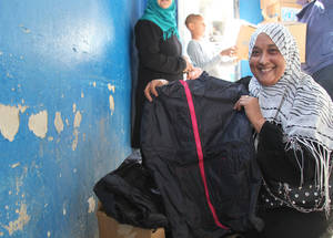 The UKAID contribution brought relief to Palestine refugees in Khan Dunoun this season as they received new clothing to help them keep warm this winter. Khan Dunoun, Damascus © 2015 UNRWA Photo by Taghrid Mohammad