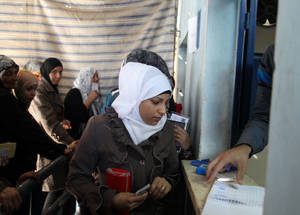 UNRWA distributed 2,878 boxes of clothing over the course of a week. Each kit included winter jackets, sweaters, hats, vests, scarves, socks and underpants for two adults and two children. Khan Dunoun, Damascus © 2015 UNRWA Photo by Taghrid Mohammad