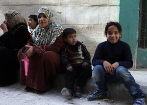 The UKAID contribution helped keep Palestine refugee children warm during the winter; children were among the main recipients of this distribution. Khan Dunoun, Damascus © 2015 UNRWA Photo by Taghrid Mohammad