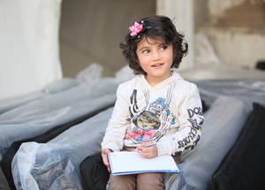 The Islamic Relief USA contribution helps keep Palestine refugees warm to endure the cold winter; children are among the main beneficiaries of this distribution. Alliance distribution centre, Damascus. © 2016 UNRWA Photo by Taghrid Mohammad