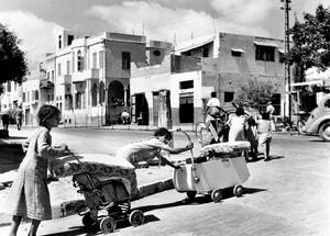 Girls push their belongings in prams and carts as they leave Jaffa. © 1948 UN Archives, Photographer Unknown