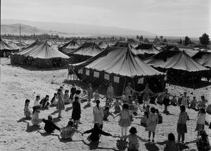 Children play outside their tent schools at Ghor Nimreen camp, Jordan. © 1967 UNRWA Archive, Photographer Unknown