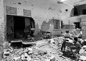 Ruins of the Galilee Preparatory Boys School in Shatila camp, Beirut, Lebanon. © 1985 UNRWA Archive Photo by H. Haider