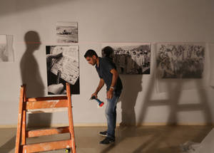Setting up the UNRWA digital archive exhibition