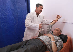 Fifty-eight-year-old Abu Abdallah, who attends physiotherapy sessions, is determined to recover as much mobility as possible after having suffered from a stroke seven years ago. Through community-based rehabilitation centres, patients can obtain a diverse range of services, such as occupational or speech therapy and physiotherapy. Khan Dunoun physiotherapy unit, Damascus. © 2016 UNRWA Photo by Taghrid Mohammad