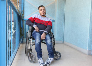 """Despite having an injury in my spinal cord, it's a blessing that I am able to play basketball. My ultimate goal is to get a university degree and have an administrative job,"" said 20-year-old Samer. A law student at Damascus University, he is also a member of the Jaramana camp disability committee and provides support to other persons with disabilities. He has been paralysed since the age of six when he fell down the stairs. Jaramana community centre, Damascus. © 2016 UNRWA Photo by Taghrid Mohammad"