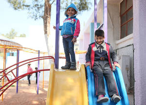 UNRWA believes in the importance of recreational activities as a means to support the psychosocial well-being of children in shelters. The Agency runs eight safe learning spaces and 21 recreational playgrounds in Syria supervised by teaching staff and psychosocial support counsellors to provide protected space for refugee children to learn and play. These safe-learning spaces welcomed more than 5,500 students in 2015. Damascus Training Centre (DTC) Collective Shelter, Damascus, Syria. © 2016 UNRWA Photo