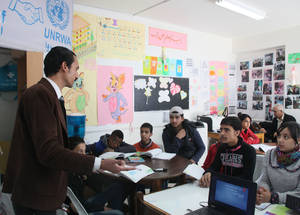 To help children cope with the stress of war and avoid falling behind in school, UNRWA runs a summer learning programme for more than 10,000 Palestine refugee children. Participating schools organize recreational and creative activities and provide support in mathematics, Arabic, English, French, music, sports and arts.  DTC collective shelter. © 2016 UNRWA Photo by Taghrid Mohammad