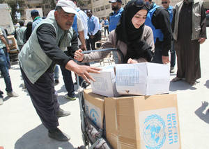 Following intense fighting in Yarmouk between extremist armed groups that had interrupted the Agency's work in the area from 7 April to 1 May, UNRWA was able to resume operations in Yalda on 2 May. UNRWA Distribution Point, Yalda, Syria. © 2016 UNRWA Photo by Taghrid Mohammad