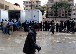 Residents in besieged areas have acute needs. For the residents of Yarmouk, after an eight-month hiatus, UNRWA resumed its delivery of life-saving assistance to 6,000 families in Yarmouk, Yalda, Babila and Beit Saham from February to May. Families were given food, blankets and hygiene kits, as well as primary health services and dental care through mobile clinics. Yalda Distribution Point, Yalda, Southern Damascus, Syria, February 2016. © 2016 UNRWA Photo
