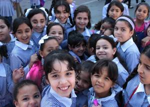 A group of girls in Balata refugee camp gathered in the school yard. School counseling plays an important role in responding to the difficult challenges facing schools and students in the West Bank. They work to create a violence-free environment and provide students with psychosocial support as they pursue their studies. © 2016 UNRWA Photo by Shaza Ghadia