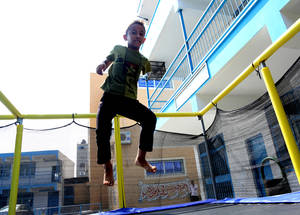 "Twelve-year-old Omer Abu Dlaj lives in Bait Lahiya in northern Gaza. He was severely injured during the 2008 hostilities and his arm needed to be amputated. During the SFWs, UNRWA actively encourages the participation of children with disabilities into its activities and services to foster social inclusion and provide them with equal opportunities to learn and play. ""I most like the trampoline; it makes me feel like a bird in the sky.""said Omer. © 2016 UNRWA Photo by Hiba Kreizim"
