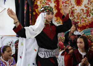 "Eleven-year-old Amera al-Loul was introduced to her own cultural heritage through the SFWs. ""I am excited to experience some of our grandparent's traditions, such as the social ritual of the Palestinian wedding party,"" said Amera. ""We sing traditional songs, we laugh and we dance and this makes us happy."" © 2016 UNRWA Photo by Roshdi al-Saraj"