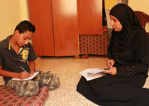 Iyad's mother helps him with his homework on a daily basis and supports him as he works on his understanding and comprehension of the materials. © 2016 UNRWA Photo by Maysoon Mustafa