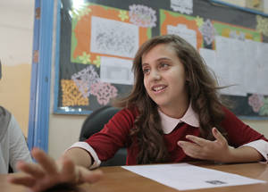 """We are too close to the main road and the noise outside can distract both us and our teachers,"" said Rana Raed, the head of the School Parliament at Qusor Girls' School. ""We close the window, but it leaves little air inside so we have to open it again."" © 2016 UNRWA Photo by Ahmad al-Ameen"