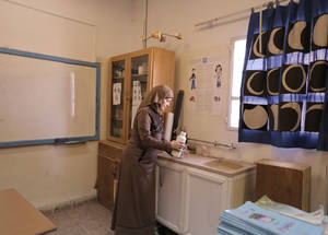 """The science lab lacks a proper disposal system and space for each student to conduct experiments as required by the curriculum,"" said Lama Hourani, a science teacher at Qusor Girls' School. ""Students are not actively engaged; they are more in the observer seat."" © 2016 UNRWA Photo by Ahmad al-Ameen"