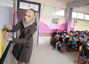 UNRWA is running 21 learning spaces in communities and shelters across Syria. Managed by staff who received safety and security training, the safe spaces provide a secure environment for all children who attend. Khan Dunoun camp, Rif Damascus, Syria, February 2016 © 2016 UNRWA Photo by Taghrid Mohammad