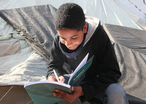 Many displaced students do not have safe access to UNRWA premises. To help them bridge the learning gap, UNRWA provides self-learning material, both online and offline. Khan Dunoun camp, Rif Damascus, Syria, February 2016 © 2016 UNRWA Photo by Taghrid Mohammad