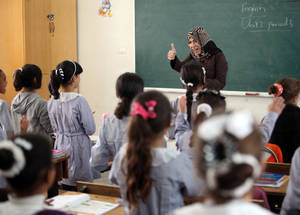 Teachers are the single most important educational resource for UNRWA. A 2014 World Bank study on the UNRWA education programme found the Agency's teachers to be a key component to the UNRWA schools outperforming host schools by a margin equivalent to more than one additional year of learning. © 2015 UNRWA Photo
