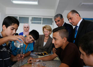 In this photo, the Director of UNRWA Operations in Jordan, Roger Davies (second from right), joined the Ambassador of the United States to the Hashemite Kingdom of Jordan, Alice Wells (centre), during the inauguration of the UNRWA Nuzha School in 2015. The newly constructed school replaced unsafe buildings that were used by nearly 2,000 students and 77 education staff. © 2015 UNRWA photo