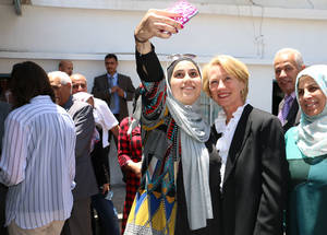 "Ninth-grader Enas Ayman takes a selfie with Alice Wells, the US Ambassador to Jordan. ""I participated in the parliament more than once. I won twice. It is amazing to know that your colleagues like you, trust you and have selected you to be their leader,"" said Enas. © 2016 UNRWA Photo by Viola E. Bruttomesso"