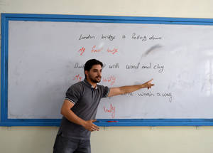 "Anas Jarrad, an English teacher at Nuzha Preparatory 1 Boys School in Jordan, introduced a Young Leadership programme three years ago to promote social engagement among students at the school. ""Students build leadership skills by identifying areas for improvement in the school as well as in the local community,"" he explains. ""This year, there are a number of student-led projects to promote volunteering, plant trees and raise academic achievement."" © 2016 UNRWA Photo by Natacha Bazin"