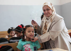 UNRWA provides students with Self-Learning Materials (SLMs) and offers summer programmes, as well as psychosocial support to students affected by the conflict. Palestine school, Alliance, Syria. © 2016 UNRWA Photo by Taghrid Mohammad