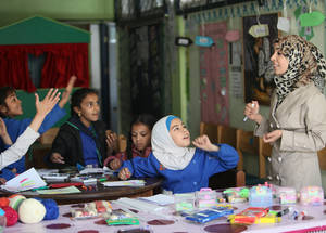 Teachers run the UNRWA Summer Learning Programme to prepare students who fell behind due to the ongoing conflict to catch-up in their studies. The Agency has set up eight Safe Learning Spaces and 21 recreational playgrounds in the war-torn country. Khan Dunoun, Syria. © 2016 UNRWA Photo by Taghrid Mohammad