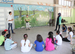 Teachers provide students with a safe place to engage in remedial classes so that they can participate in recreational activities and receive psychosocial support. These activities are designed to gradually help children recover from trauma and prepare them to re-enter a regular classroom setting. Al-Neirabin, Damascus, Syria. © 2016 UNRWA Photo by Taghrid Mohammad