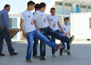 Students at the Kalandia Boys' School practice dabke, the traditional Palestinian folkloric dance, during EU Summer Fun Day activities in August 2016. © 2016 UNRWA Photo by Tala Heitawi