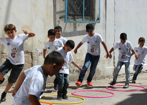 The EU Summer Fun Days provide safe spaces for Palestine refugee children to play. Crowded camp conditions and a lack of open recreational spaces present many refugee children with few alternatives in the summer when school is not in session. © 2016 UNRWA Photo by Tala Heitawi