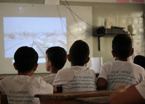 Students participating in the annual EU Summer Fun Days at Kalandia Boys' School watch educational films about the European Union and its long-standing history of supporting Palestine refugees. © 2016 UNRWA Photo by Tala Heitawi