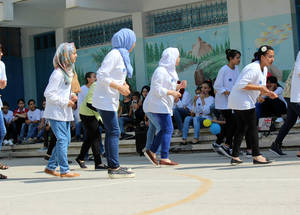 Girls at the Askar Basic Girls' School in Nablus practice their dance choreography during the EU Summer Fun Days in August 2016. © 2016 UNRWA Photo by Tala Heitawi
