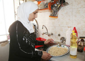 The prices prompted Wala'a to work in a candy store to ensure an income for her family. She recently had to quit her work because she had to accompany her 13 year-old daughter, who has leukaemia, to chemotherapy sessions at the hospital.  Jaramana Camp, Syria © 2016 UNRWA Photo by Taghrid Mohammad