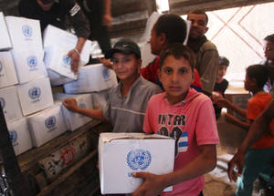 Among the stress and uncertainty of life, UNRWA food assistance is a reliable source of support that helps sustain their resilience as the conflict in Syria continues relentlessly. Jaramana Camp, Syria © 2016 UNRWA Photo by Taghrid Mohammad
