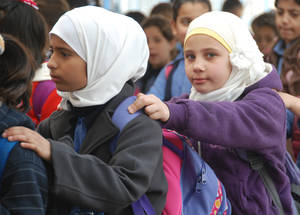 Girls lining up to go to class. Often, Palestinian children from Syria come from impoverished and vulnerable families. Parents cite poverty, fear and trauma as reasons to not send their children to school. UNRWA continuously reaches out to these families to enrol their children and follow up with drop-outs.