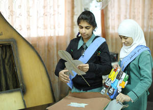 School parliament members prepare a puppet show. Amir Hasan Girls School #1 hosts 90 children from Syria. The students' school parliament works with teachers and parents to keep children from Syria from slipping through the cracks by integrating the girls into the school community.