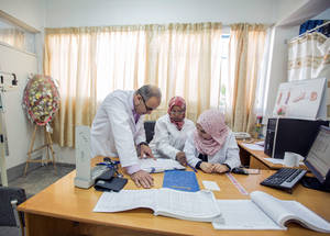 UNRWA health personnel during their work at the UNRWA Rimal Health Centre in Gaza City. Each Family Health Team manages approximately the same number of family files, which has greatly improved patient flow in the clinic and equalized the workload among staff. © 2016 UNRWA Photo by Hussein Jaber